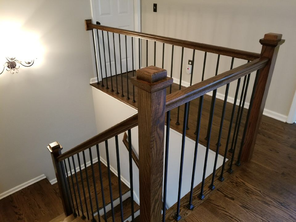 Hardwood Staircase Gallery. Dark Walnut With Straight Iron Balusters