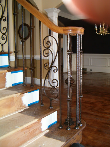 gothic style iron baluster staircase image